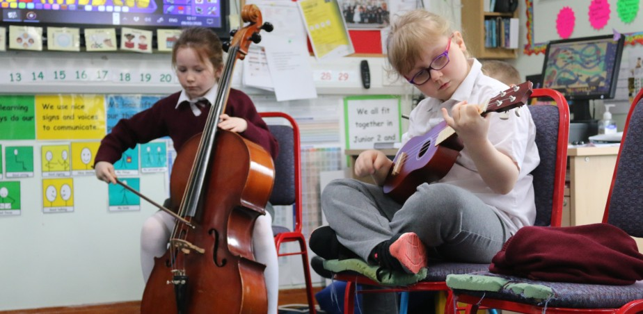 Practicing and recording the score for 'The Lonely Traveller' written by the class.