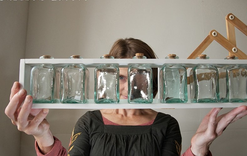 Artist Lucy Hill examines her Death Jars, part of her interactive Children's art exhibition 'paint' at the Linenhall Arts Centre, Castlebar. Photo Alison Laredo