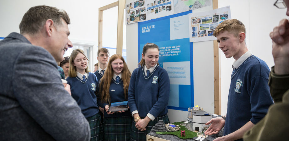 Image: students from Coláiste na Mí presenting their work to architect Dermot Bannon at the Architects in Schools 2018/19 exhibition in GMIT Galway. Photo by Ste Murray